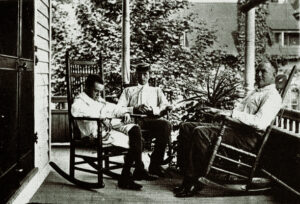 Eugene O'Neill, his brother and father, on the porch of Monte Cristo in Connecticut