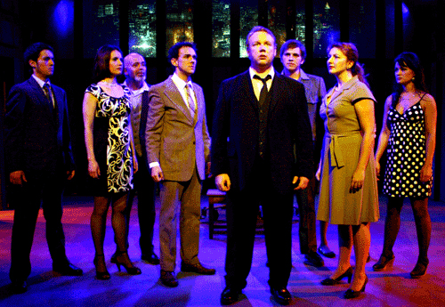 eremy Fillinger, center, with Kyle Cooper, Laura M. Hathaway, Richard Comeau, Ryland Dodge, Andrew Eddins, Amie Bjorklund and Liz Holt in 'Merrily We Roll Along' at Chance Theatre