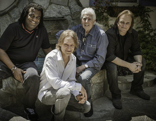 John Mayall and his band: Drummer Jay Davenport, bassist Greg Rzab, Mayall, and guitarist Rocky Athas