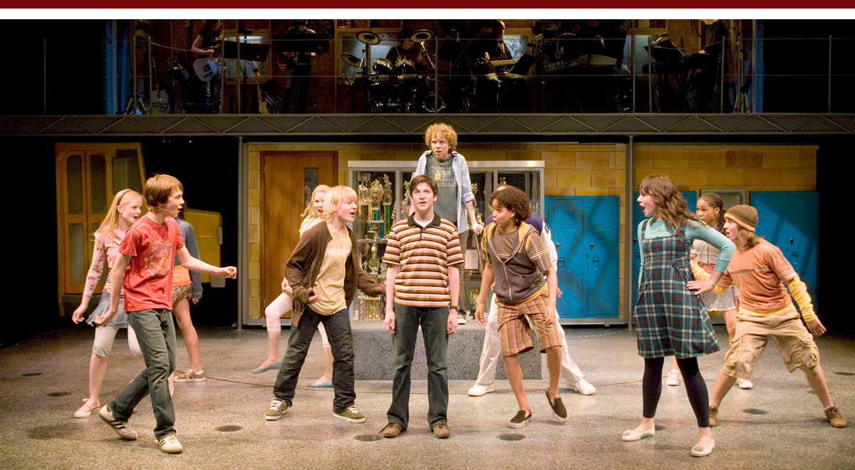 Ricky Astley (stripes), center, Tyler Mann (behind him), and cast members in '13' by Jason Robert Brown and Dan Fish at the Mark Taper Forum, photo by Craig Schwartz