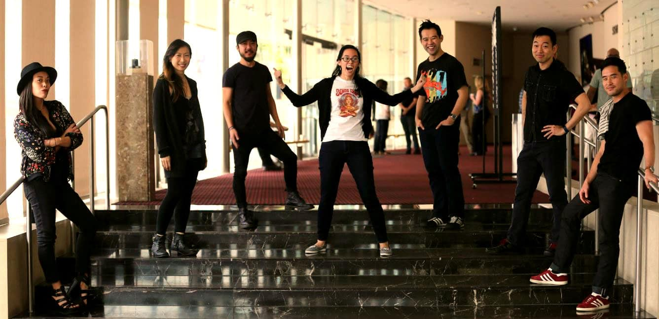 Playwright Lauren Yee flanked by her Rock Band cast on the first day of rehearsal: (from left) Brooke Ishibashi, Jane Lui, Abraham Kim, Joseph Ngo, Daisuke Tsuji and Raymond Lee. (Danielle Bliss/SCR)